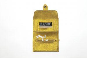 blague a tabac jaune paillete galerie eber-specher-maroquineries